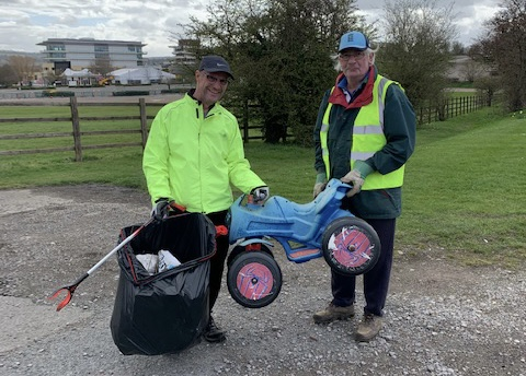 Volunteer pickers with toy car